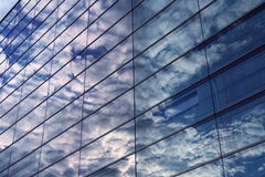 Office Building. Sky and glass wall of an office building, reflections of clouds Royalty Free Stock Images