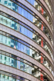 Office Building Abstract Curve. Modern round office building abstract architecture, reflections on windows Stock Photography