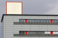 Office building advertising on the roof. Office building with grey walls and advertising cube on the roof Stock Photography