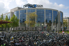 Office building Aegon and bike shed of station. Netherlands: contemporary architecture the modern edifice of Aegon, that is a multinational life insurance Royalty Free Stock Photo