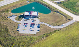 Office Building aerial photograph. Aerial view of modern office facility with parking lot and pond Stock Images