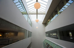 Office building atrium. Modern office building interior atrium with skylight and incandescent lighting Stock Photos