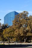 Blue Office Building Against Blue Sky Autumn Trees Royalty Free Stock Images