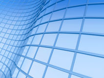 Office building on a background of the blue sky. Curves and rectangles of building windows Stock Image