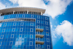 Office Building - blue sky and clouds reflections Stock Photos