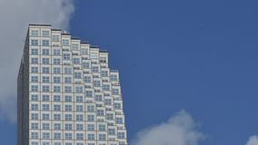 Office building on a blue sky 4k uhd video stock video