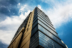Office Building. Blue office building under blue white sky Royalty Free Stock Photo