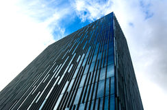 Office Building. Blue office building with vertical thin stripes Royalty Free Stock Images