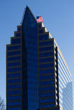 Office Building With Blue Windows And US Flag Royalty Free Stock Photography