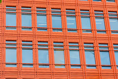 Office building with bright orange front. Stock Photos