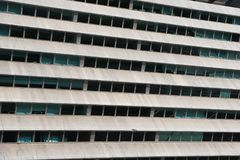 Rows of windows in concrete facade office building Stock Photography