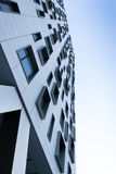 Office building viewed from the street. On a clear blue sky Royalty Free Stock Photo