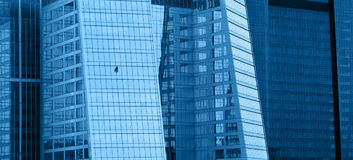 Office building close-up. Blue office building horizontal background stock photo