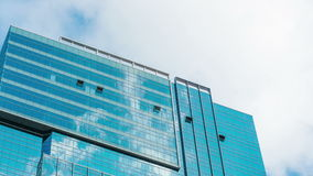 Office building and cloud reflection 4K tight shot stock video