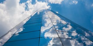 Office building on a cloudy day.Blue sky in the background.Cente. R angle.Horizontal view Royalty Free Stock Photography