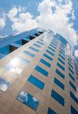 Office building on a cloudy day.Blue sky in the background.Left. Angle Royalty Free Stock Image