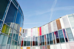 Office building with colourful glass front Royalty Free Stock Images