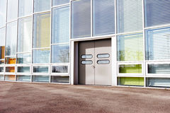 Office building with colourful glass front Royalty Free Stock Photos