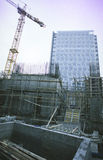Office building constructions and crane Stock Photos