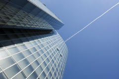Office building and contrail in the sky Stock Photo