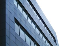Office building corner steel glass window corporation skyscraper. Building corner window steel wall modern office perspective royalty free stock image