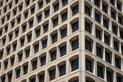 Office Building Corner View. A corner perspective view of an office building with tinted windows in precast concrete casements royalty free stock photo