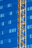 Office Building and Crane Stock Image