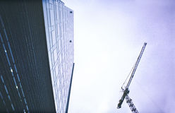 Office building and crane Royalty Free Stock Images