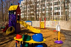 Office building daycare center. A colorful, well-equipped, fenced playground that is part of a daycare center for children of employees at a modern business and Royalty Free Stock Photo