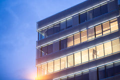 Office building detail. Illuminated modern office building detail night shot stock photo