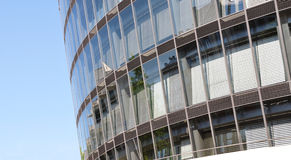 Office building - detail. Modern architecture – façade of an office building with reflections in the windows royalty free stock image