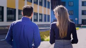 Office building. The director of business center and the secretary during a break on the street. The young man discusses stock footage
