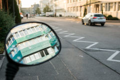 Office building in driving mirror Royalty Free Stock Photo