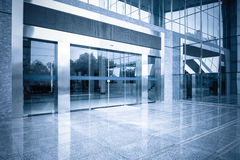 Office building entrance and automatic glass door. Modern office building gate entrance and automatic glass door with blue tone Stock Photos