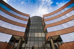 Office building exterior. In brick and glass with a blue sky Royalty Free Stock Image