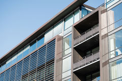 Office building exterior. Low angle, abstract shot of a modern office building's facade Stock Image