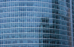 Office building facade. Modern contemporary russian architecture: exterior of a modern, futuristic office building facade in Moscow with reflections of blue Stock Photography