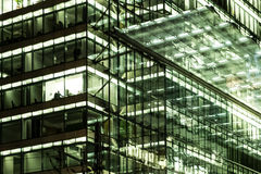 Office building facade at night -city lights Stock Images