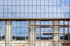Office building facade under construction with scaffolding Stock Image