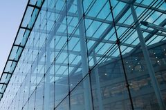Office building with glass exterior on a clear day Royalty Free Stock Image