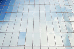 Office building. Glass facade of the office building with sky reflection stock image