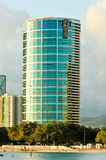 An office building in Honolulu reflect in bay Royalty Free Stock Photography