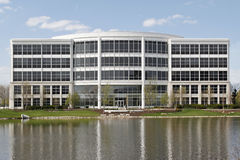 Office building with lake. Office building in suburbs with lake in back Stock Photography