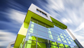 Office building with motion blurred clouds. Royalty Free Stock Photo
