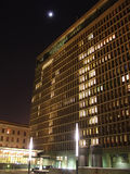 Office building at night. With moon in background Stock Photo
