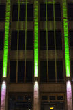 Office building at night with green lights on its facade Stock Photo