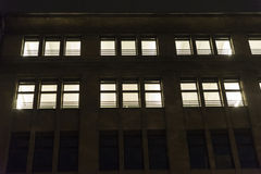 Office building at night with lighted windows Royalty Free Stock Images