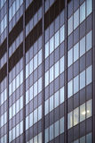 Office building one light room window pattern. Office building window pattern one light in one room day skyscraper typical for northern america Royalty Free Stock Photos