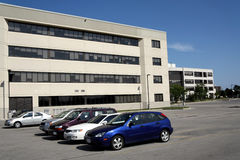 Office building and parking lot Stock Photography