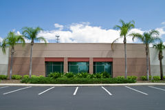 Office Building with parking spaces. Side of office building with parking spaces and palm trees stock photography